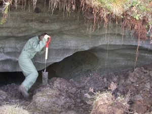 researcher exploring permafrost